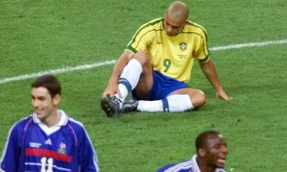 Ronaldo sits dejected on the pitch as Robert Pires of France and Patrick Vieira celebrate after the 1998 World Cup final.