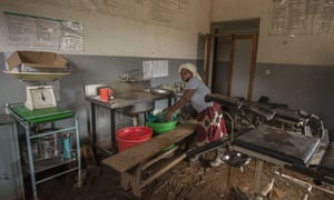 A nurse clears medical equipment at a health centre in Makhanga damaged by flooding in January 2015