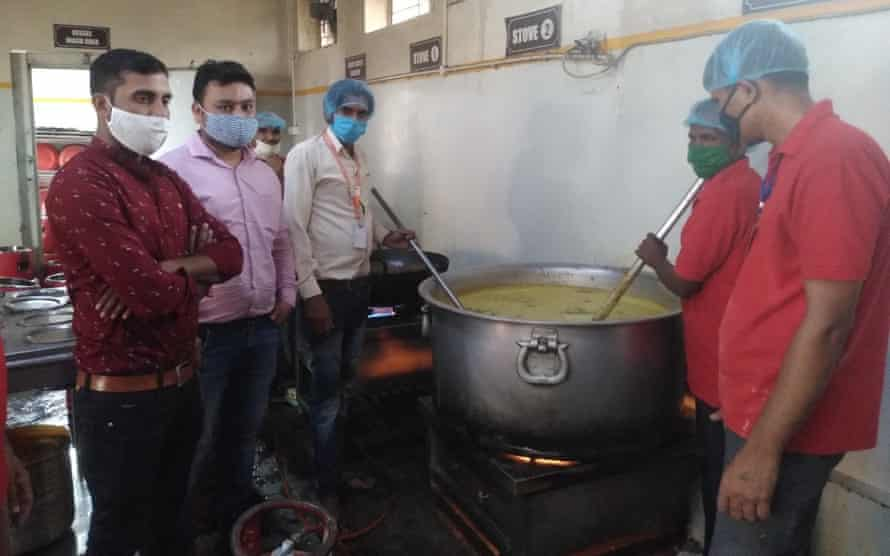 Men take part in cookery session as part of job skills training.