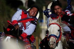 Todos Los Santos Cuchumatan, Guatemala Participants enter an annual horse race for drunk riders