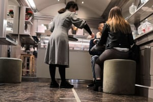 Customers sit inside a pastry shop in Padua, northern Italy