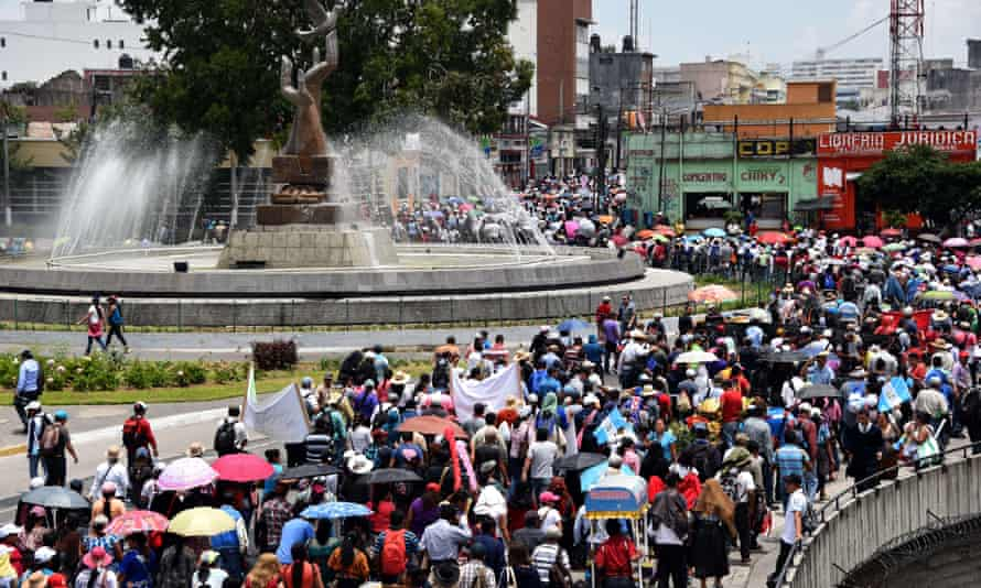 Hundreds of teachers demonstrate along the streets of Guatemala City on 26 August as a corruption scandal has sparked mass protests.