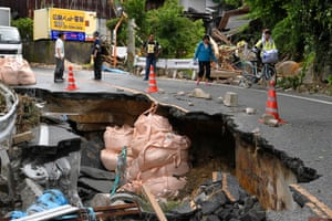 Residents on a damaged road as an evacuation order is issued in Hiroshima