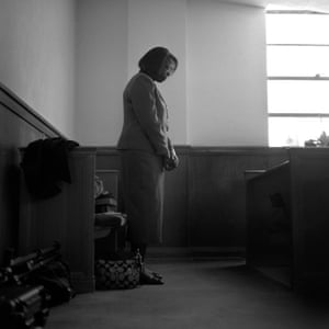 A woman prays in the back of First Baptist Church during it's 122 year anniversary celebration, December 2010