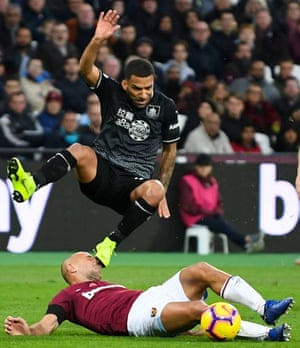 Burnley's Aaron Lennon catches West Ham's Pablo Zabaleta as he jumps the tackle.