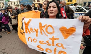 A supporter of Keiko Fujimori holds a banner reading 'Keiko is not alone' outside a police facility in Lima on Wednesday.