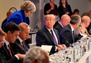 Room for a little one? Theresa May takes her place by President Trump at dinner