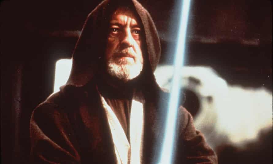 Alec Guinness as Obi-Wan Kenobi.