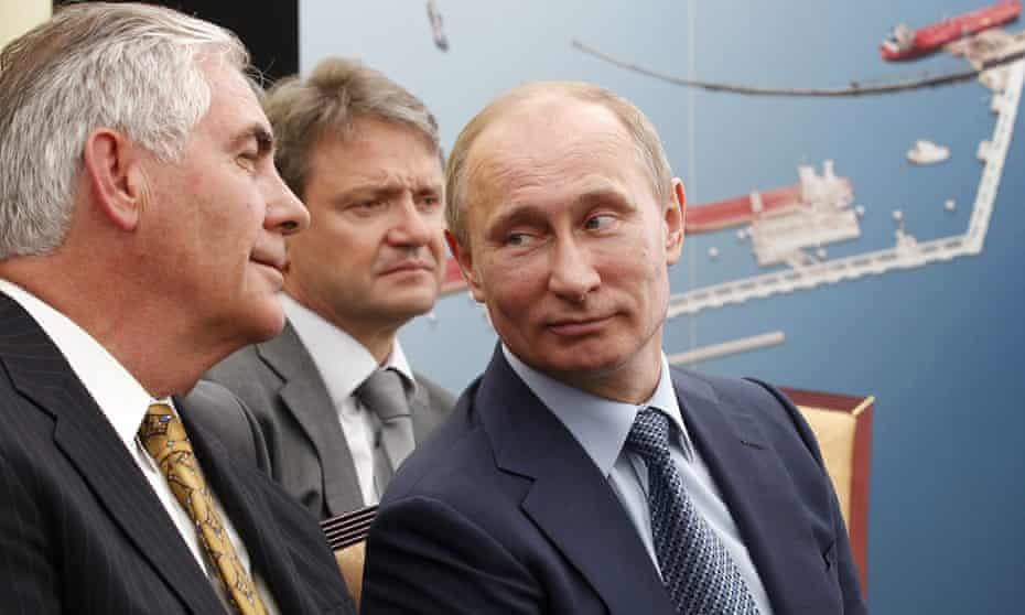 Rex Tillerson, left, is seen with Russian president Vladimir Putin and Krasnodar governor Alexander Tkachev at the signing of an agreement between Rosneft and Exxon Mobil.
