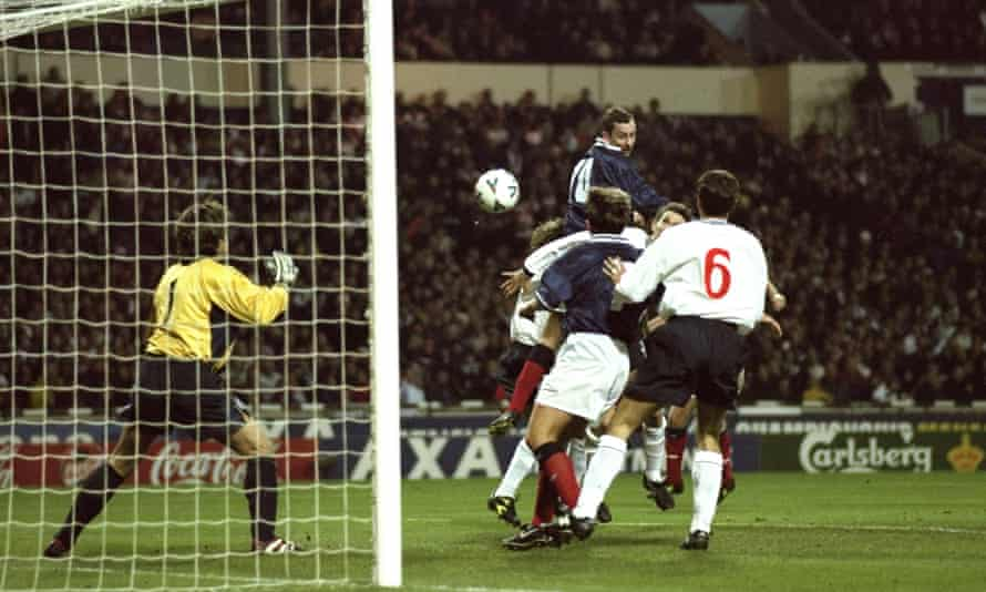 Don Hutchison guides a header past David Seaman to score Scotland's goal at Wembley in 1999.