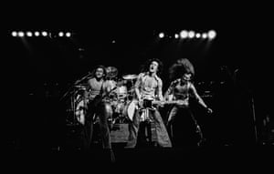 Van Halen perform live on stage at Lewisham Odeon in London on 27th May 1978. Left to Right: Michael Anthony, Eddie Van Halen, David Lee Roth.
