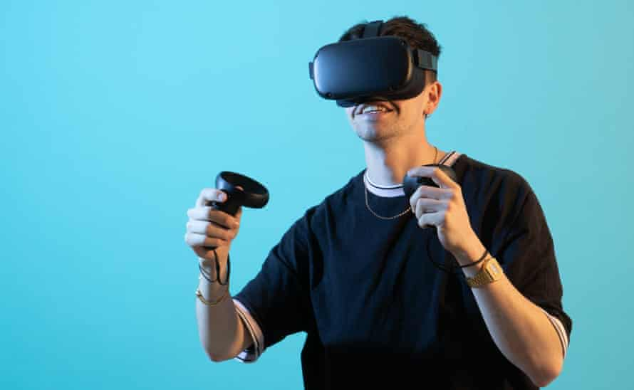 a young man wears the oculus quest headset