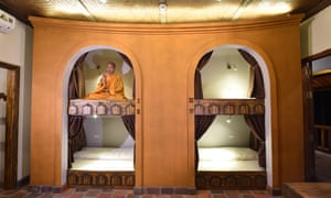 Dorm beds in the village lodge with monk