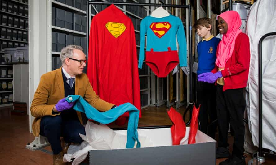 Students with an original costume from the 1987 film Superman IV: The Quest for Peace.