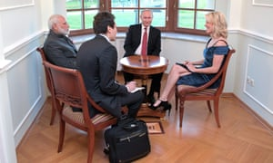 NBC journalist Megyn Kelly, right, smiles as she interviews India's Prime Minister Narendra Modi, left, and Russian President Vladimir Putin.