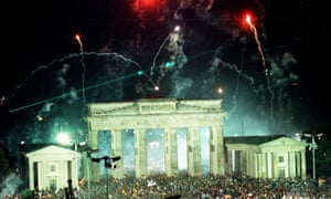 Fireworks exploding over the Brandenburg Gate in Berlin on 3 October 1990 as tens of thousands gathered to celebrate the reunification of the two Germanys.