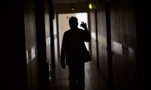 """A patient walks in a corridor of the psychiatric hospital """"EPS de Ville Evrard, Centre psychiatrique du Bois de Bondy"""", on May 7, 2020, in Bondy, France"""