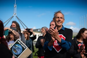 Bob Brown applauding after over 5000km of driving from Hobart to Clermont, Central Queensland and back to Canberra the Stop Adani Convoy has a final rally on the Lawns of Parliament House.