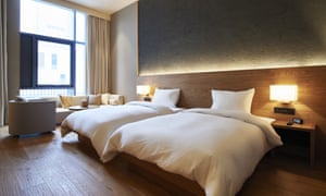 A bedroom at Muji's Shenzhen hotel, which opens on 18 January. China.