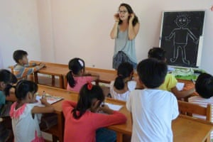 Ruth Vechoeff, a Dutch volunteer of non-profit organisation Greenway China, gives an English lesson in Langshan Village, Lianhua, southwest China's Guangxi Zhuang Autonomous Region