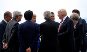 Donald Trump speaks with fellow G7 leaders at the summit in Taormina.