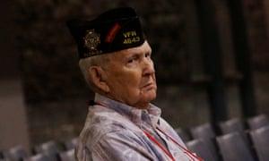 A veteran watches Donald Trump speak.