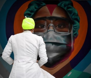 A health worker passes in front of a mural painted to honour the work of medical teams against the Covid-19 pandemic at the Ana Francisca Perez de Leon State Hospital in Caracas, Venezuela. The president, Nicolas Maduro, announced on Wednesday the presence of the Brazilian variant in the country.