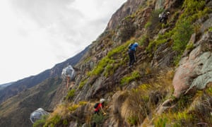 Reaching 'the world's first hanging lodge' involves climbing a via ferrata up the valley.