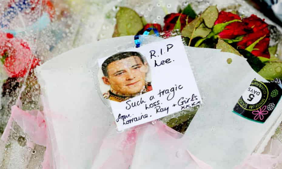 Floral tributes and a photograph of Lee Rigby with a message reading 'RIP Lee. Such a tragic loss'