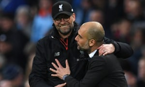 Liverpool manager Jurgen Klopp (L) embraces Manchester City manager Pep Guardiola after the match ended in a 1-1 draw