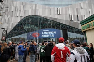 Fans arriving at the venue before the game. The Tottenham Hotspur Stadium was designed with American football in mind as the ground provides separate facilities for the NFL players.
