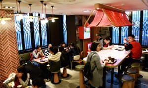 Customers inside the new McCafe restaurant in Hangzhou.