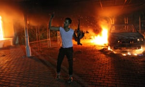 An armed man before the blazing US consulate in Benghazi, 11 September 2012.