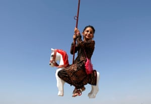 Kabul, Afghanistan: A girl rides on a swing