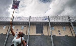 A woman protests at Harmondsworth detention centre in Middlesex.