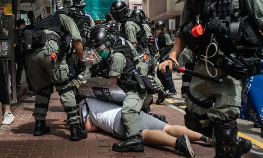 A man is detained by Hong Kong riot police during a demonstration on Wednesday