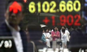 An electronic board shows the stock indicator of a securities firm in Tokyo.