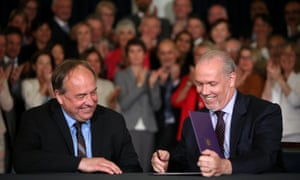 BC Green leader Andrew Weaver and BC New Democrat leader John Horgan sign a coalition pact to replace the Liberal government in British Columbia, Canada May 30, 2017.