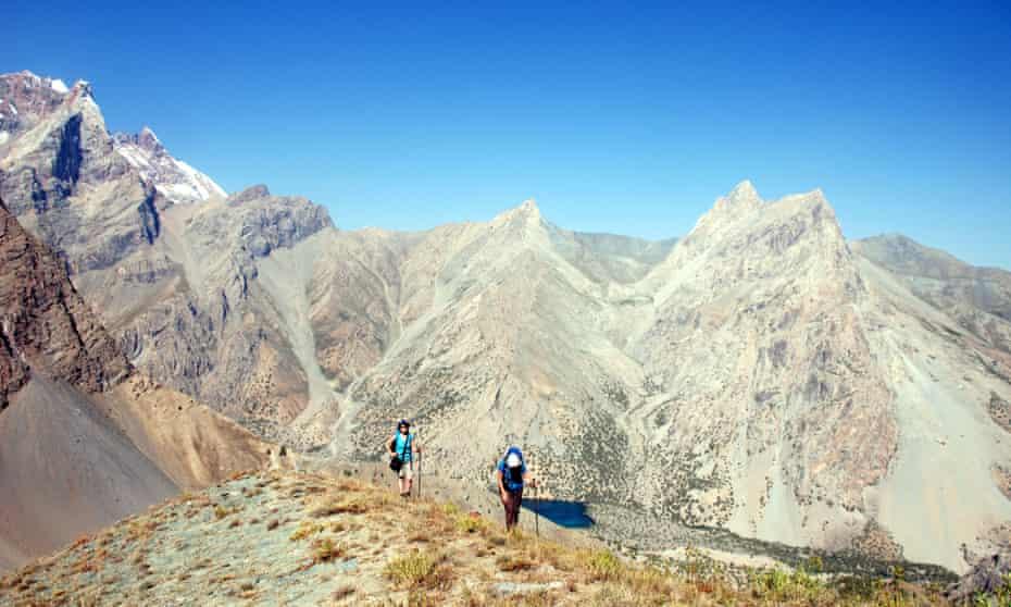 Trekkers on a high ridge in the Fann mountains of Tajikistan.