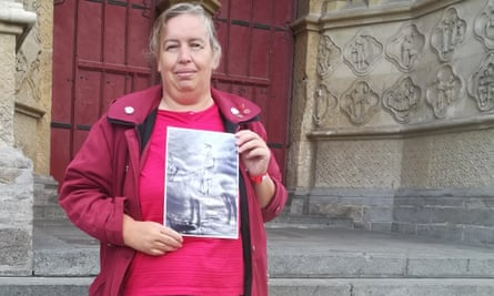 Sarah Clarke-Feltham holds a picture of her grandfather George Clarke on his blind horse.