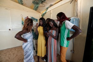 Young surfers who are coached by Khadjou Sambe, Senegal's first female professional surfer, and Rhonda Harper, the founder of Black Girls Surf (BGS)