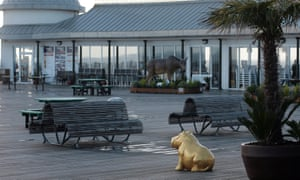 One of the controversial golden hippopotamuses on the pier.