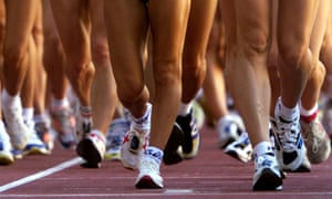 The legs of athletes taking part in a race