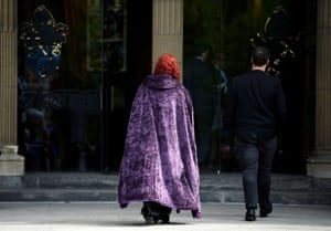 A mourner wearing a Harry Potter themed cloak arrives at for the service