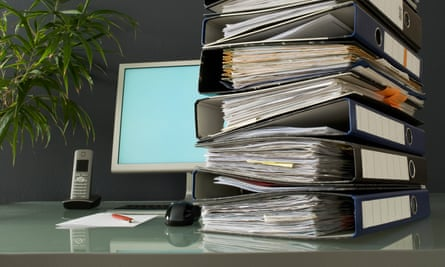 Stack of ring binders on a desk