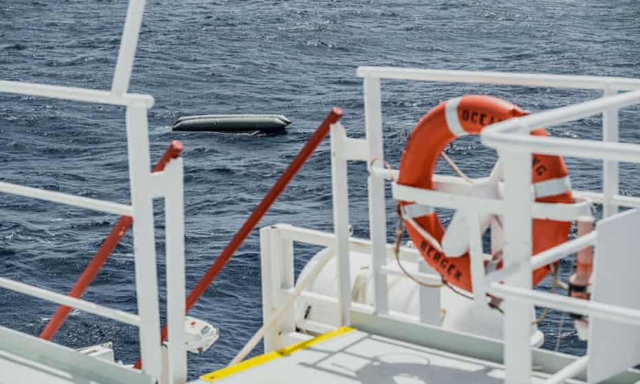 A rubber boat is seen after it capsized in the Mediterranean