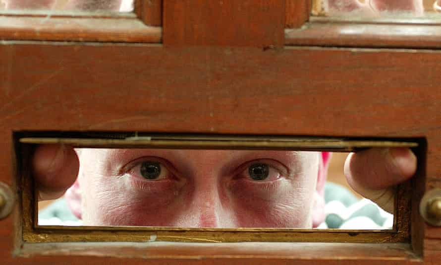 Bailiff looking through a letterbox