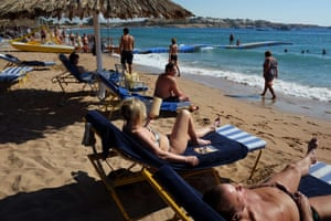 Tourists enjoy the beach in the Egyptian Red Sea resort of Sharm el-Sheikh.