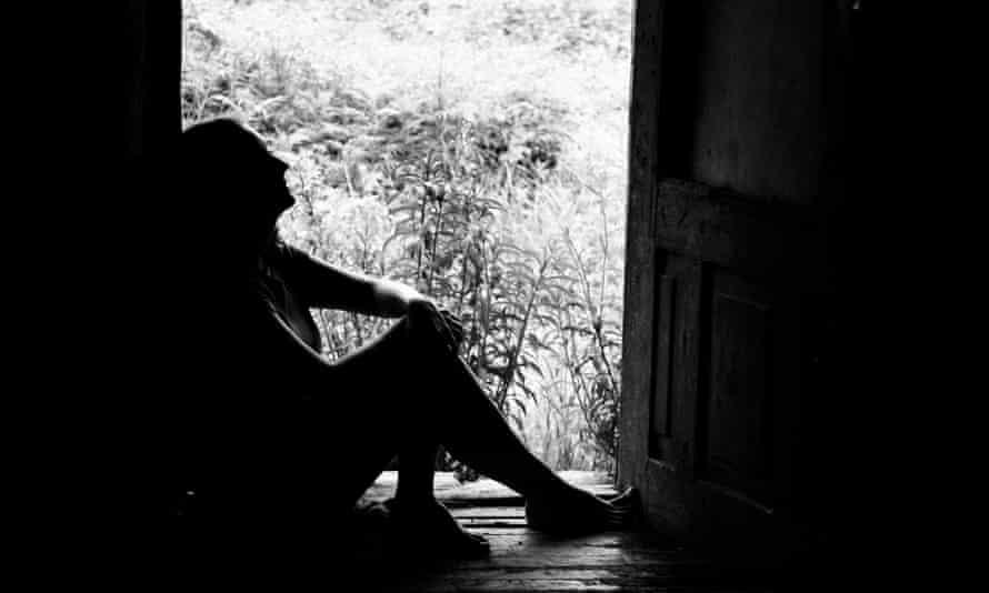 Silhouette of a woman in doorway