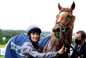 Jockey Emmet McNamara celebrates with Serpentine after winning the Investec Derby.